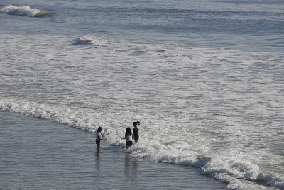 girls playing in the pacific ocean