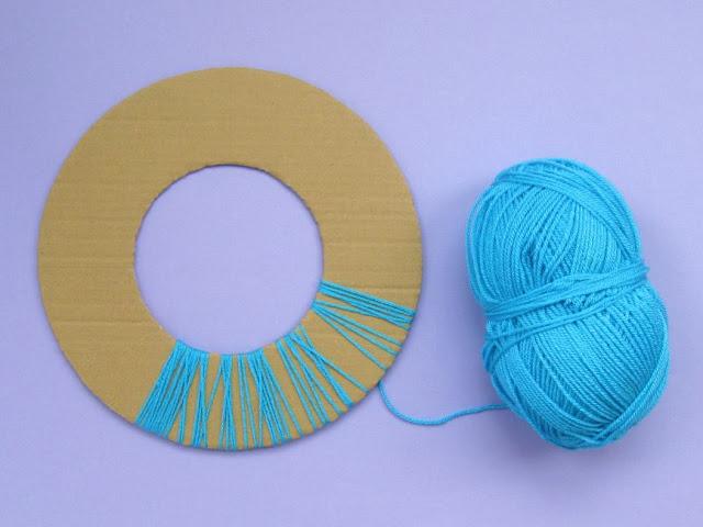 wrap the wreath base with yarn