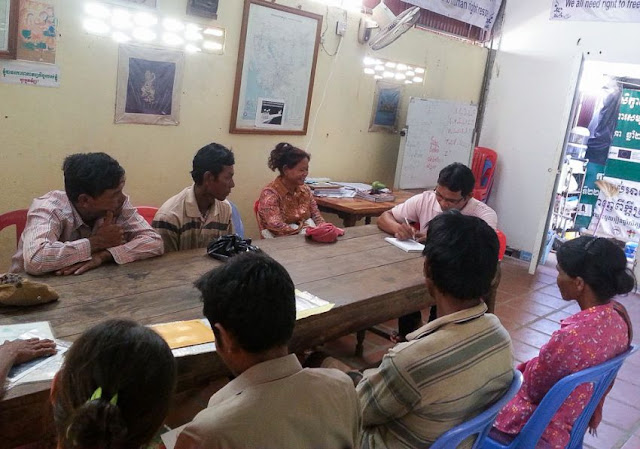 Family members of migrant workers in Malaysia meet with an ADHOC official yesterday in Tbong Khmum province. Photo supplied