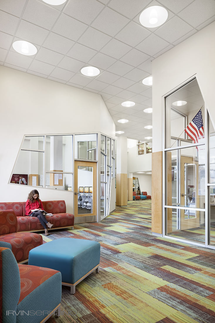 A student sits on a couch in the newly renovated library and media center at Thorton Academy.