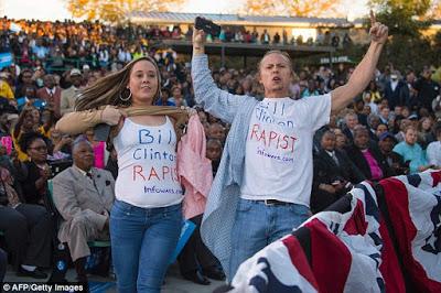 Bill 'rape' protesters interrupt President Obama