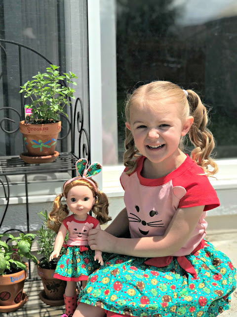 American Girl WellieWishers Willa Review, American Girl WellieWishers, WellieWishers Willa, How to paint terra cotta planters, what type of paint to use on terra cotta, what type of paint to use outside on pots, How to create a personalized herb garden, DIY hand painted herb garden, Amazon Prime American Girl Shows,
