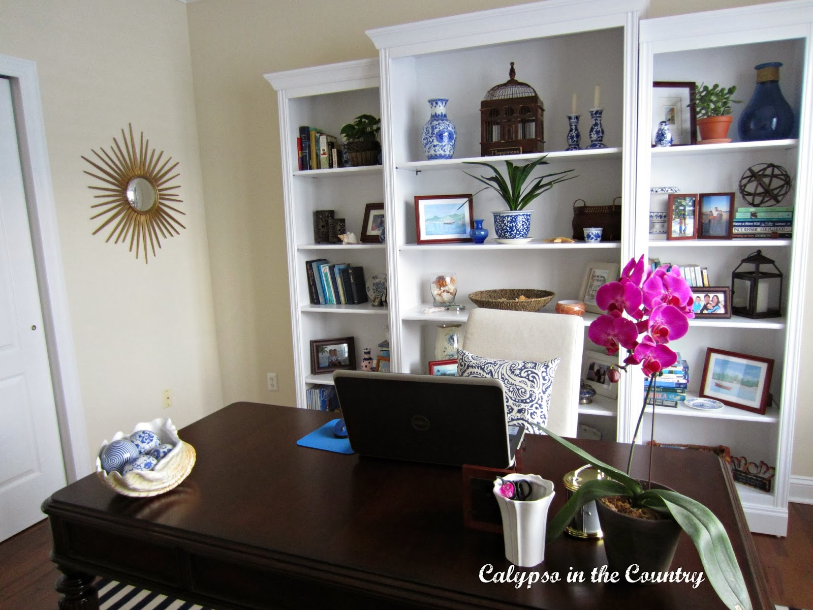 White Bookcases in blue and white home office
