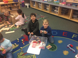 Students in Preppy K centers on the floor
