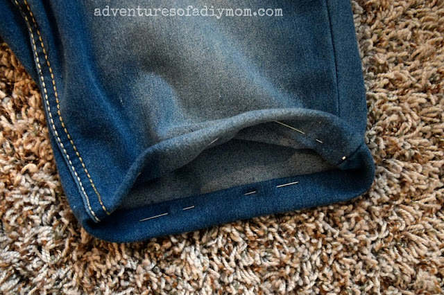 roll jeans up and pin in place