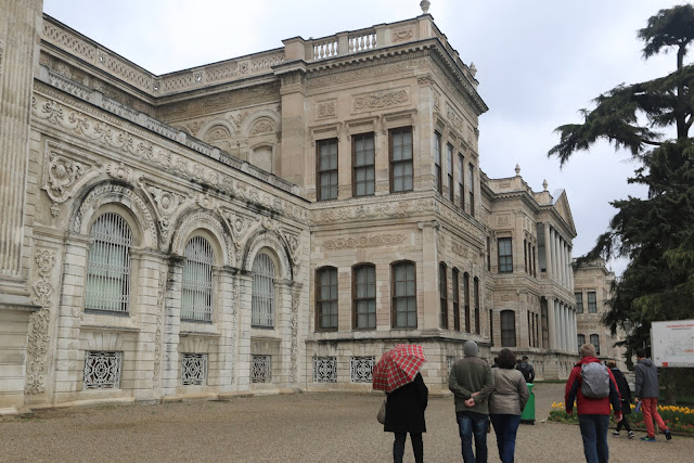 Admiring big western style buildings in Dolmabahce Palace near Taksim Square in Istanbul, Turkey