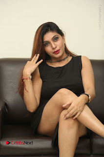 Tollywood Upcoming Actress Pooja Roshan Stills in Black Short Dress at Plus 1 Movie Trailer Launch  0267.JPG