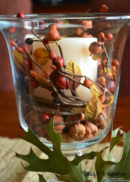 glass hurricane with fall berries and vase fillers