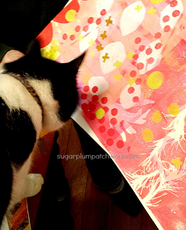 Cat inspecting painting
