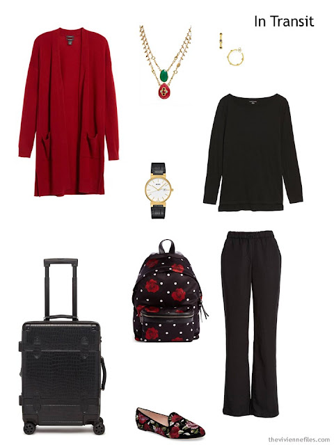 travel outfit in black and red with rose accents