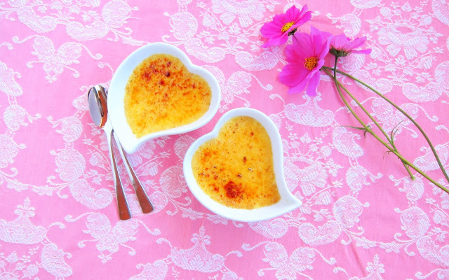 Two heart ramekins with pressure cooked crema catalana with bruleed sugar top