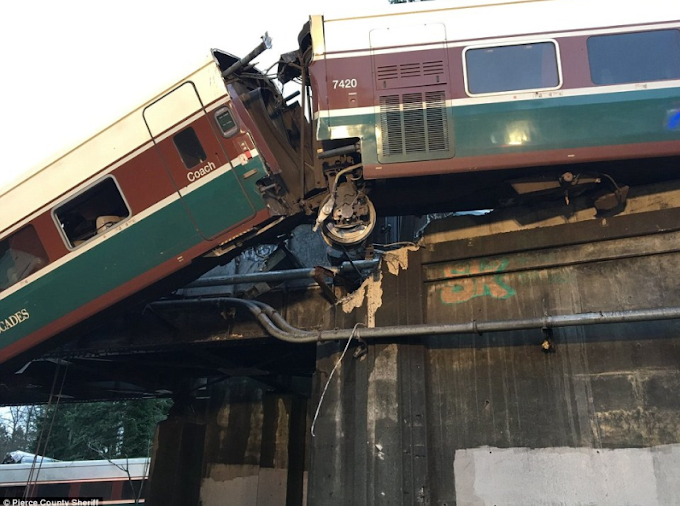 Amtrak train crash: People confirmed dead after train 'carrying 200 people' derails off Washington bridge onto busy highway