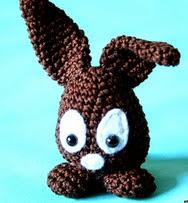 http://www.ravelry.com/patterns/library/easter-egg-bunny---osterhaseneierkopf
