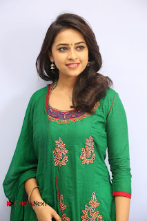 Actress Sri Divya Pictures in Green Salwar Kameez at Rayudu Team Meet  0029.JPG