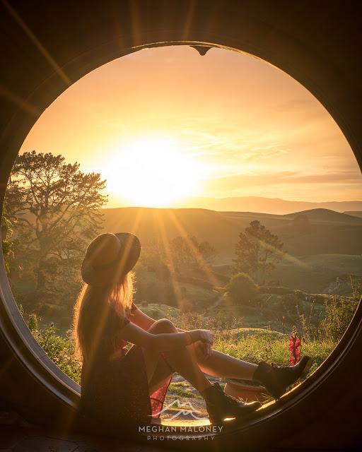 Girl at sunrise at Bag End Hobbiton