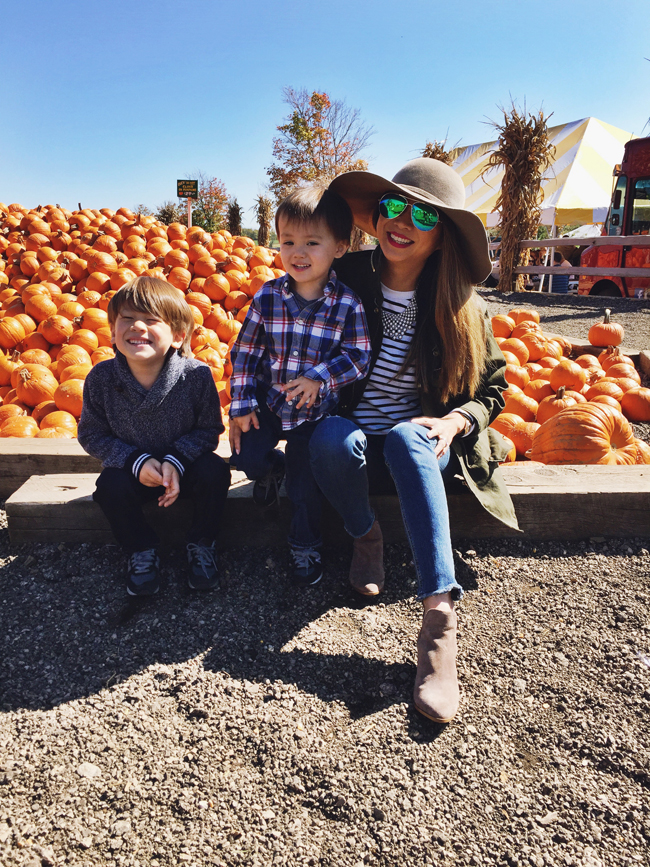 Fall Style - Hat, stripe shirt, and denim at a pumpkin farm