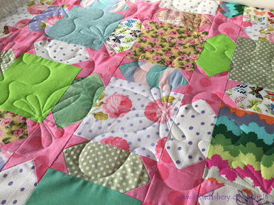 Sheila's quilt featuring 'Dragon Wings' quilting design