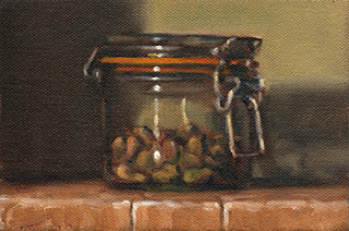 Oil painting of a small preserving jar half filled with shelled pistachios.