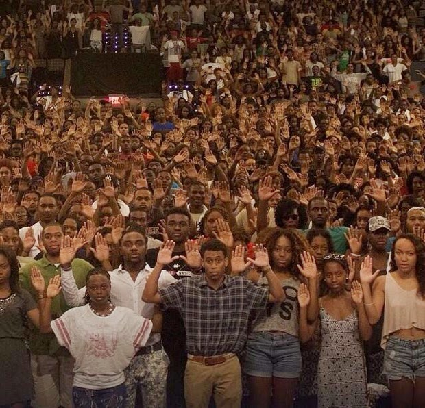 25 Photos Of People Who Will Inspire You - Howard University students pose to protest the shooting of Michael Brown in Ferguson, Missiouri. Multiple eye-witness reports claimed that Brown held his hands in the air before being fatally shot six times by police