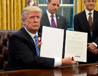 Donald Trump displays Executive Order (Credit: Ron Sachs - Pool/Getty Images) Click to Enlarge.
