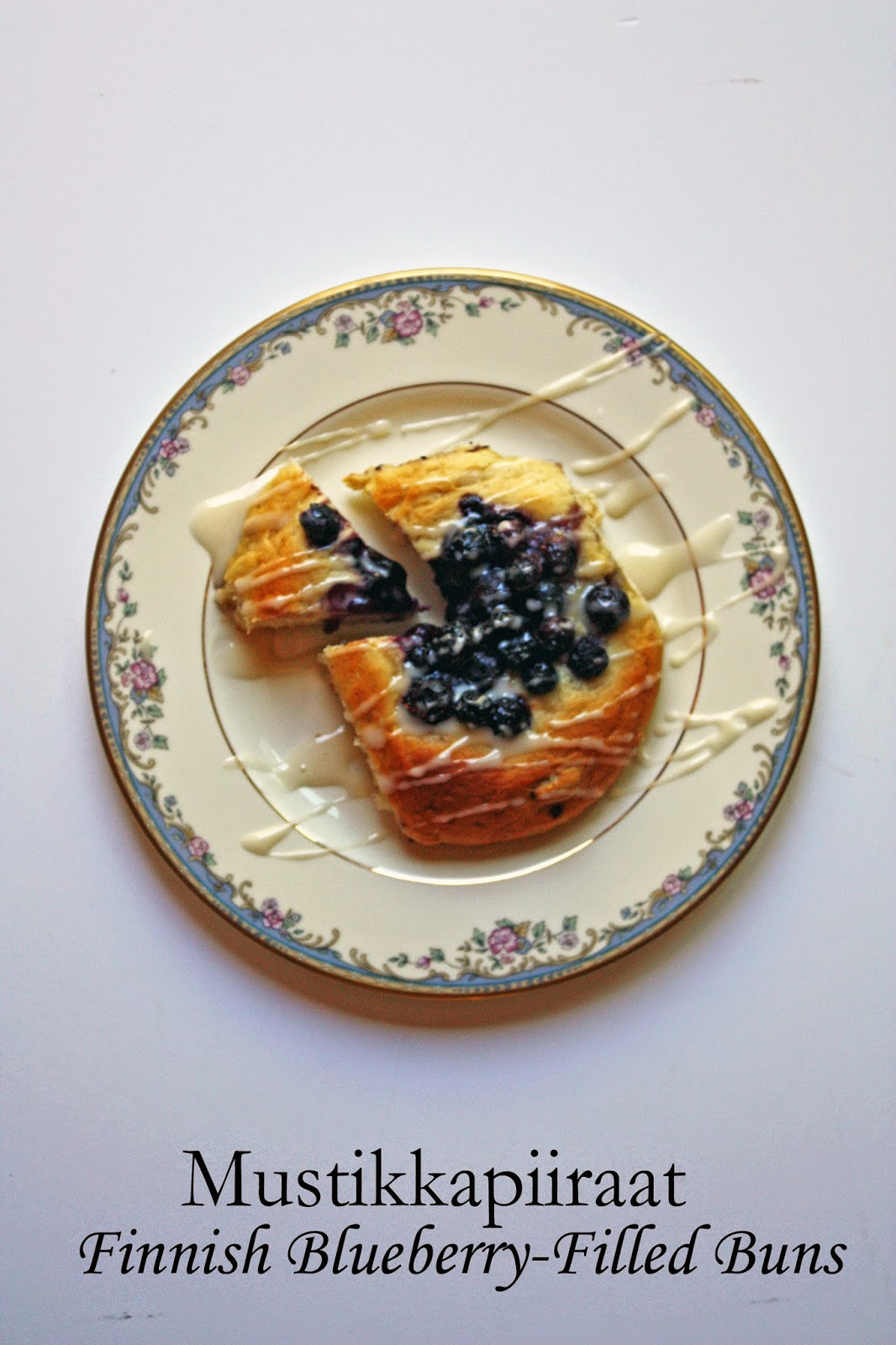 Mustikkapiiraat (Finnish blueberry-filled buns) with vanilla glaze