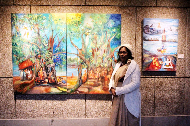 Artist Uma Bardhan with her painting