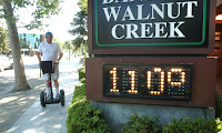 Mike Dupray rides his Segway scooter through town during a record-breaking heat wave in Walnut Creek, Calif., Saturday, July 22, 2006. (Photograph Credit: Karl Mondon/AP) Click to Enlarge.