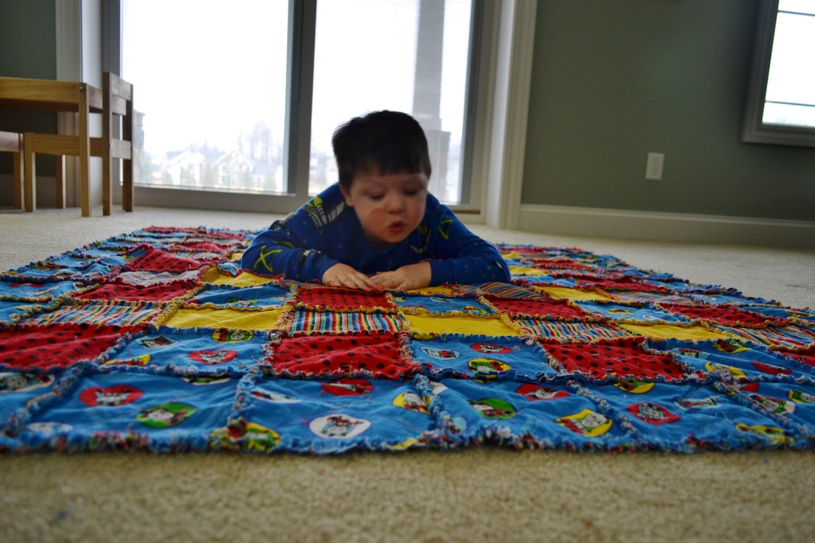 Beautiful  a Thomas the Train rag quilt for my then year old who was on year of his train obsession I uve learned quite a bit about quilting in the last three