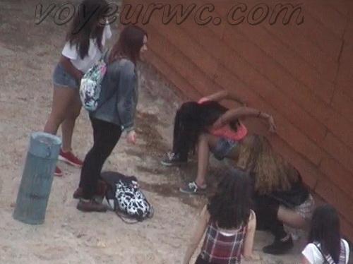 Girls Gotta Go 14 (Spanish girls peeing in public at festival)
