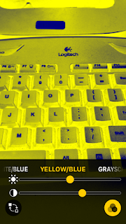 Magnifier captured an image of a keyboard and user applied yellow/blue high contrast mode