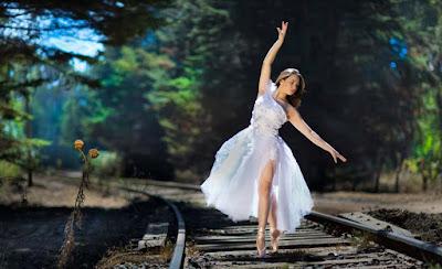 dancing-girl-on-railway-crossing-imgaes