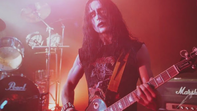 black metal band guitar player