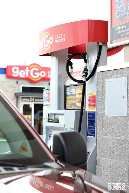 Red van at gas pump at GetGo