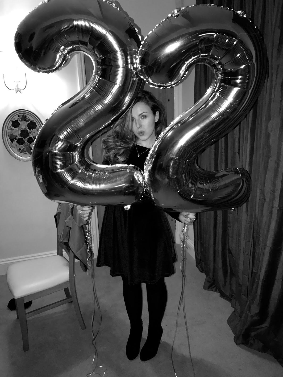 Georgia holding '22' Balloons