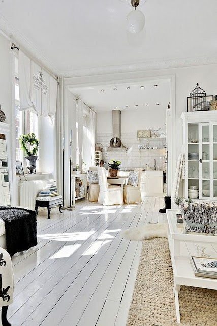 Shabby white painted wood flooring