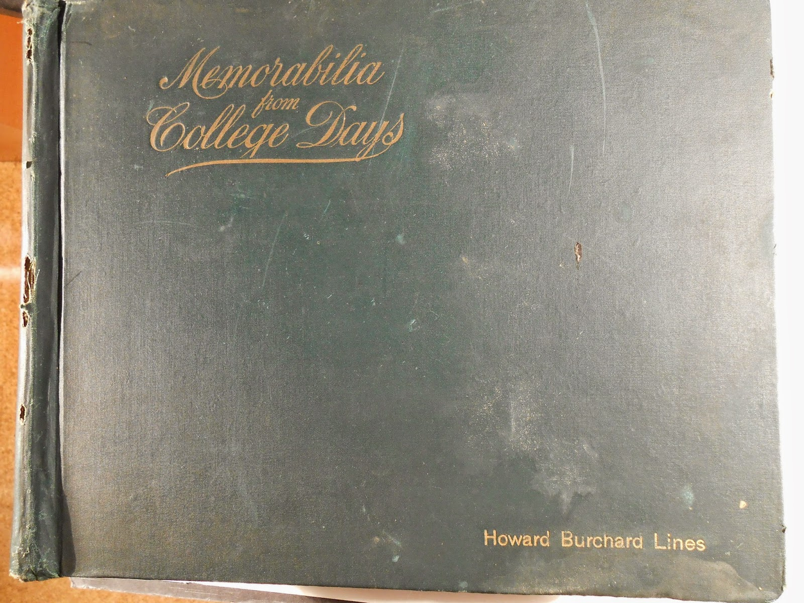 "The cover of a worn book labeled ""Memorabilia from College Days,"" with the name ""Howard Burchard Lines"" embossed on it."