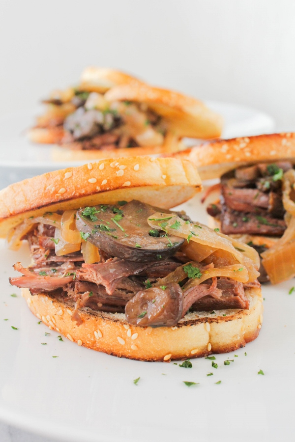 Beautiful beef brisket gets braised until tender in an easy sauce with beer, mushrooms, and onions. The meat is sliced and piled high on toasted bread to make delicious sandwiches that the whole family will love!