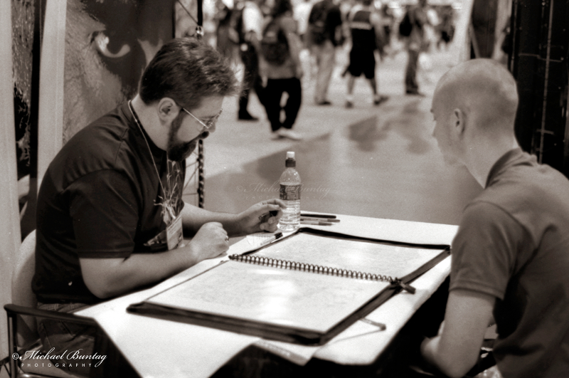 Portfolio review, Comic-Con International, San Diego Convention Center, Marina District, San Diego, California. Ilford HP5+ Black and White 35mm negative film. © Michael Buntag.