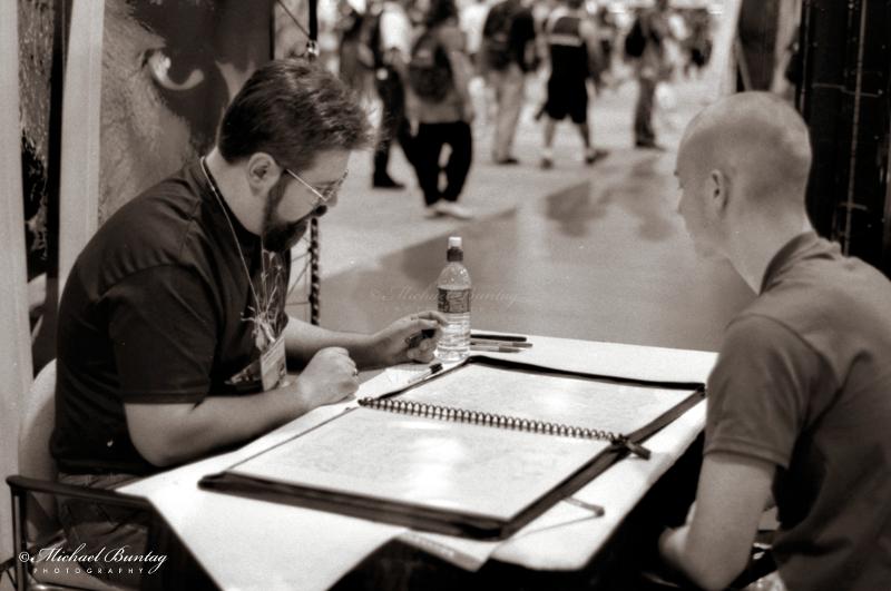 Portfolio review, Comic-Con International, San Diego Convention Center, Marina District, San Diego, California. Ilford HP5+ Black and White 35mm negative film. © Michael Buntag.