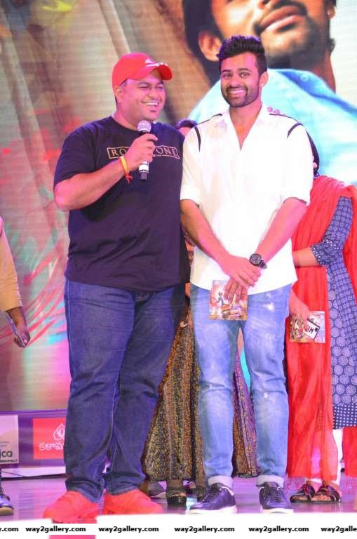 S Thaman and Sai Dharam Teja are all smiles at the audio launch of Telugu film Thikka