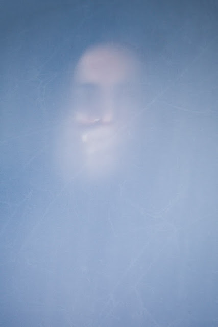 An obscured picture of a hand over a frightened woman's mouth - Marie Carr Photography