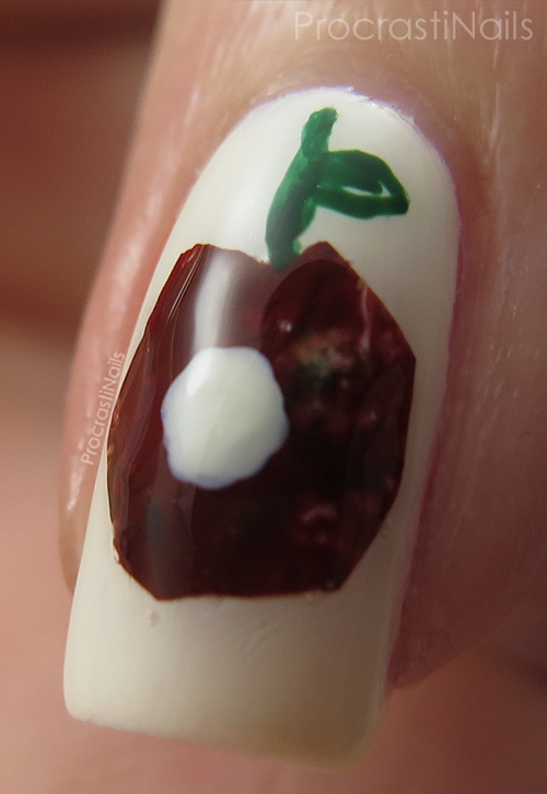 Nail art with a dark red apple from The Very Hungry Caterpillar
