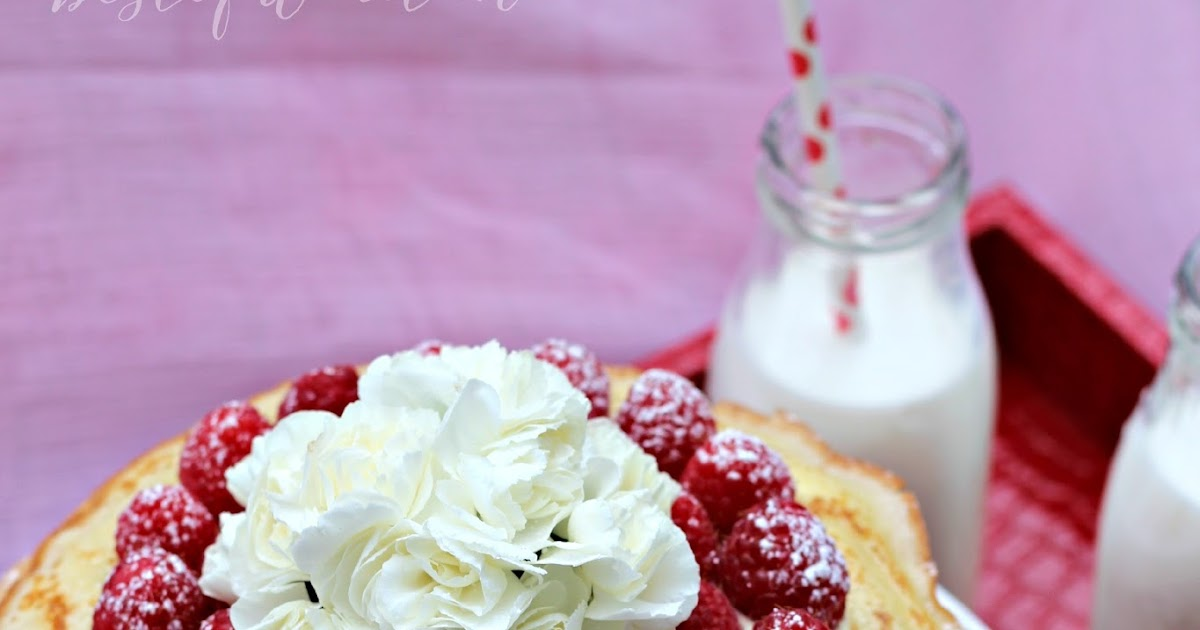 Ombre Crepe Cake With Vanilla Pastry Cream And Raspberries