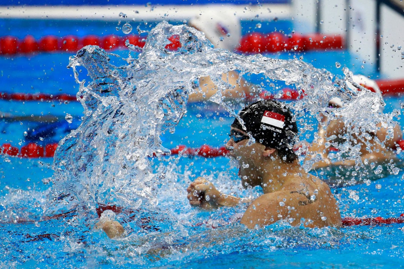 Joseph Isaac Schooling celebrates winning gold in the Men's 100m Butterfly Final on Day 7 of the Rio 2016 Olympic Games at the Olympic Aquatics Stadium on 12 August 2016.