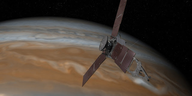 This artist's rendering shows NASA's Juno spacecraft making one of its close passes over Jupiter. Credits: NASA