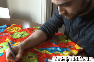 Daniel signs shirt for Loud Shirt Day