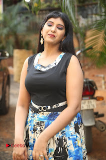 Actress Model Poorni Stills in Floral Long Dress at Silk India Expo Launch  0012.JPG