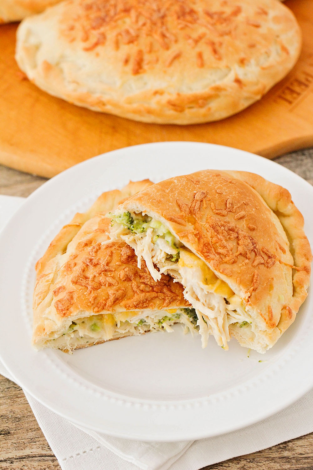 These cheesy and savory chicken and broccoli pockets are freezer friendly and perfect for a hearty lunch or easy dinner!