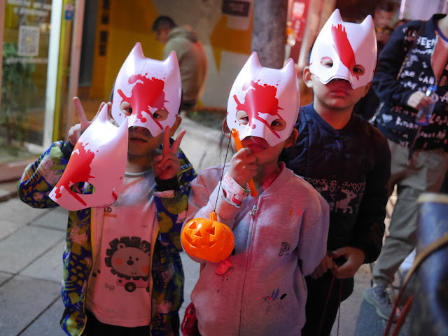 three children wearing Halloween masks in Changsha
