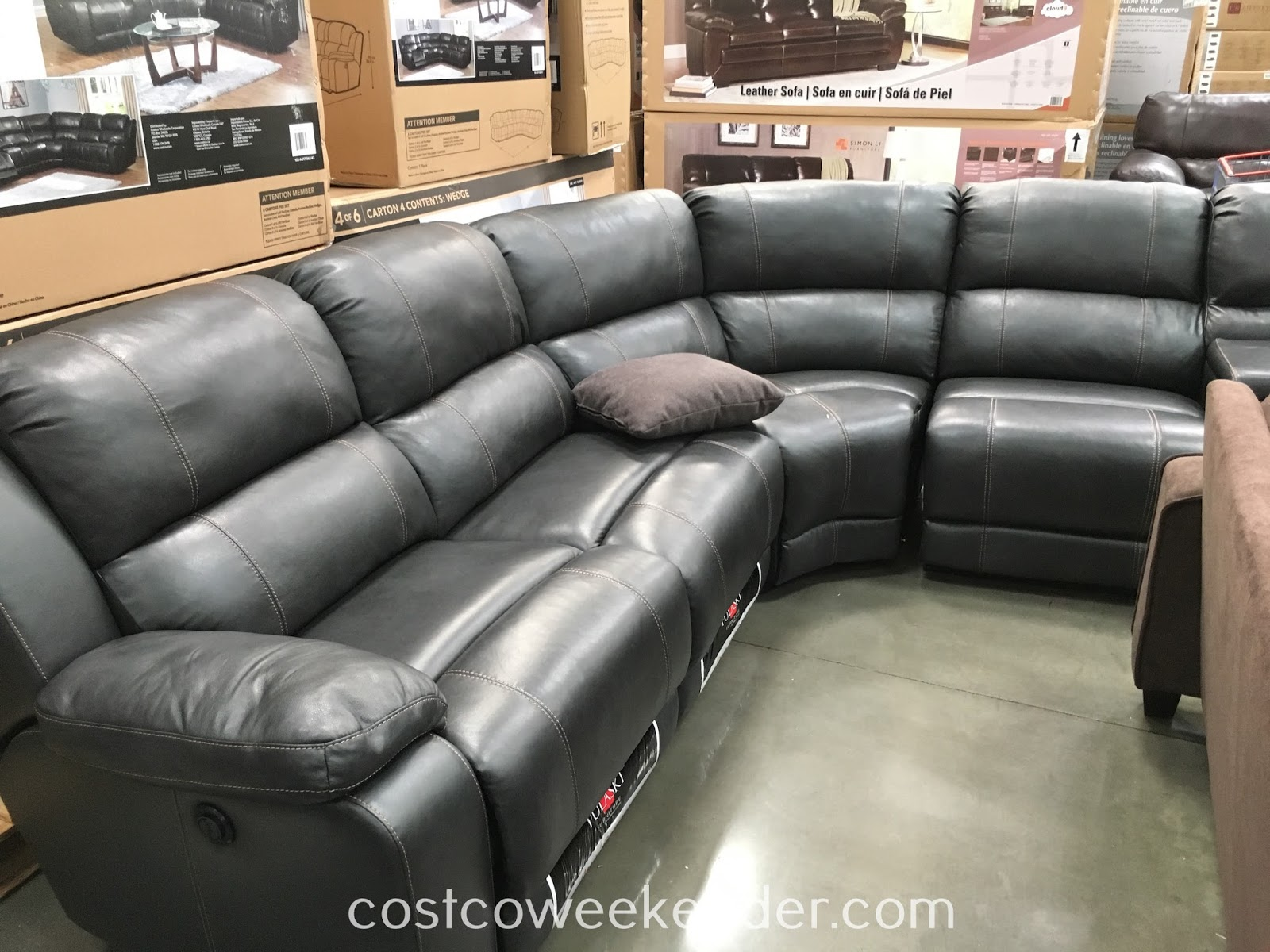 Relax in comfort while watching tv or take a nap on the Pulaski Power Leather Sectional